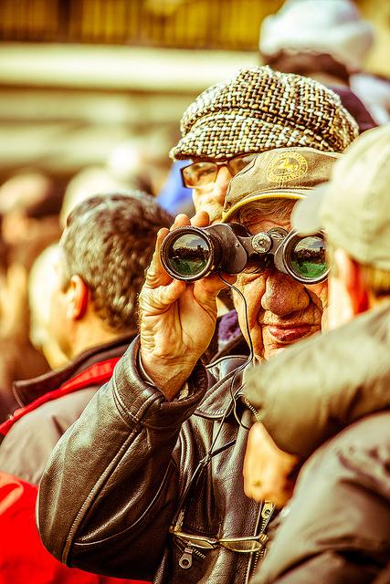 older man with binoculars